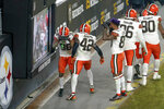 Members of the Cleveland Browns defense celebrate an interception of a pass by Pittsburgh Steelers quarterback Ben Roethlisberger during the second half of an NFL wild-card playoff football game, late Sunday, Jan. 10, 2021, in Pittsburgh.  (AP Photo/Keith Srakocic)