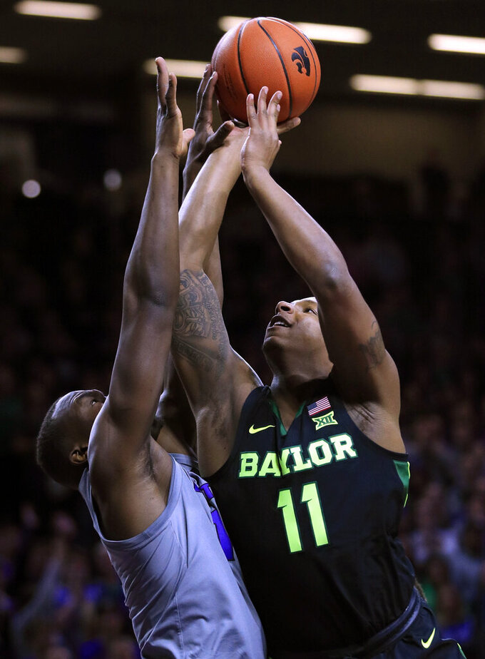 Baylor guard Mark Vital (11) shoots over Kansas State forward Makol Mawien, left, during the first half of an NCAA college basketball game in Manhattan, Kan., Saturday, March 2, 2019. (AP Photo/Orlin Wagner)