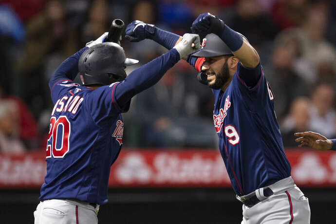 Minnesota Twins' Marwin Gonzalez, right, and Eddie Rosario celebrate Gonzalez's two-run home run during the sixth inning of the team's baseball game against the Los Angeles Angels in Anaheim, Calif., Tuesday, May 21, 2019. (AP Photo/Kyusung Gong)