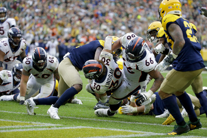 Denver Broncos running back Phillip Lindsay (30) scores during the second half of an NFL football game against the Green Bay Packers, Sunday, Sept. 22, 2019, in Green Bay, Wis. (AP Photo/Mike Roemer)