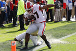 Georgia wide receiver Tyler Simmons (87) is pushed out of bound after pulling in a pass from Georgia quarterback Jake Fromm (11) during an NCAA college football game Saturday, Nov. 30, 2019, in Atlanta. (Joshua L. Jones/Athens Banner-Herald via AP