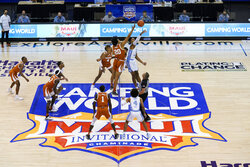 Texas forward Jericho Sims (20) and North Carolina forward Armando Bacot (5) tip off for the start of an NCAA college basketball game for the championship of the Maui Invitational, Wednesday, Dec. 2, 2020, in Asheville, N.C. (AP Photo/Kathy Kmonicek)