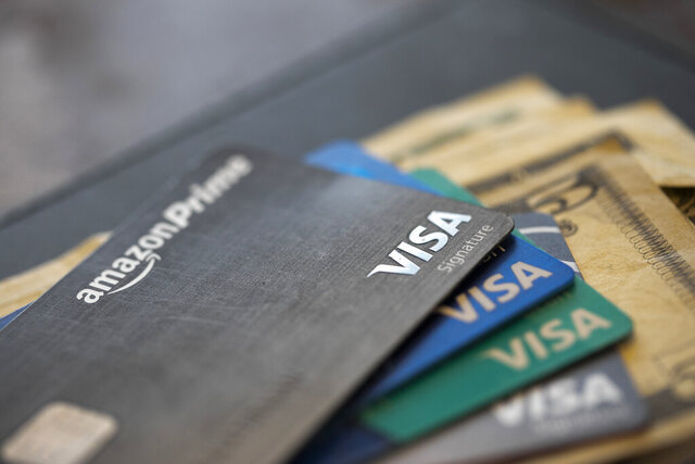 FILE - This Aug. 11, 2019, file photo shows credit cards in New Orleans. Visa is purchasing the financial technology company Plaid for $5.3 billion, a major push by the payment processing giant into other types of money transfer systems outside of Visa's traditional credit and debit card business. (AP Photo/Jenny Kane, File)