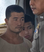 Myanmar nationals Wai Phyo, left, and Zaw Lin, right, are escorted by police officers at the Supreme Court in Bangkok, Thailand, Thursday, Aug. 29, 2019. The court has upheld the 2015 conviction of the two Myanmar migrants sentenced to death for the murder of two British backpackers on a resort island in 2014. (AP Photo/Sakchai Lalit)