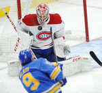 Montreal Canadiens' Carey Price (31) blocks a shot by St. Louis Blues' Sammy Blais (9) during the first period of an NHL hockey game, Saturday, Oct. 19, 2019, in St. Louis. (AP Photo/Bill Boyce)