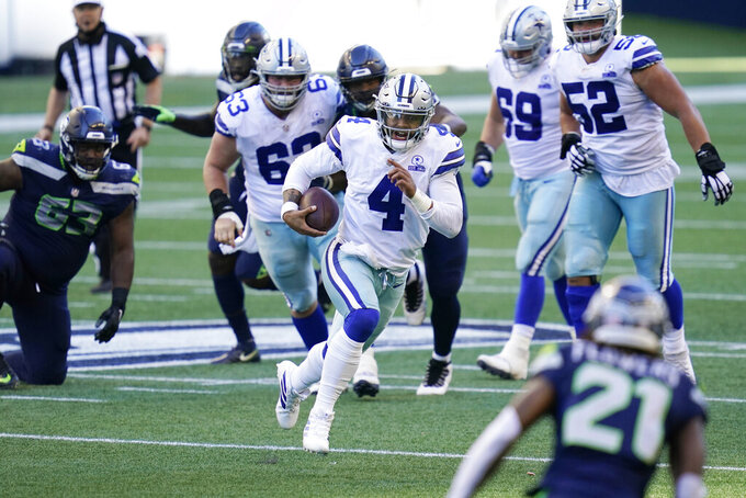 Dallas Cowboys quarterback Dak Prescott (4) scrambles against the Seattle Seahawks during the second half of an NFL football game, Sunday, Sept. 27, 2020, in Seattle. (AP Photo/Elaine Thompson)