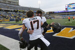 Oklahoma State quarterback Dru Brown celebrates with Dillon Stoner after an NCAA college football game against West Virginia in Morgantown, W.Va., on Saturday, Nov. 23, 2019. (AP Photo/Chris Jackson)