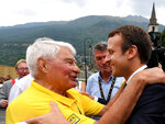FILE - In this July 19 2017 file photo, French President Emmanuel Macron speaks with former French cyclist ace Raymond Poulidor , in Saint-Martin-d'Arc, after the e 104th edition of the Tour de France cycling race between Le La Mure and Serre-Chevalier, French Alps. Tour de France organizers have confirmed that former rider Raymond Poulidor, known as
