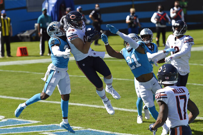 Chicago Bears tight end Cole Kmet (85) catches a touchdown pass while Carolina Panthers outside linebacker Jeremy Chinn (21) and strong safety Juston Burris, left, defend during the first half of an NFL football game in Charlotte, N.C., Sunday, Oct. 18, 2020. (AP Photo/Mike McCarn)