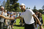 Stephen Curry greets fans while walking to the seventh tee of the Silverado Resort North Course during the pro-am event of the Safeway Open PGA golf tournament Wednesday, Sept. 25, 2019, in Napa, Calif. (AP Photo/Eric Risberg)