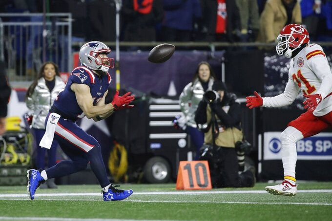 New England Patriots wide receiver Julian Edelman, left, catches a touchdown pass in front of Kansas City Chiefs defensive back Bashaud Breeland in the first half of an NFL football game, Sunday, Dec. 8, 2019, in Foxborough, Mass. (AP Photo/Elise Amendola)