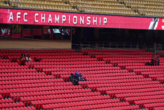 Fans watch players warmup before the AFC championship NFL football game between the Kansas City Chiefs and the Buffalo Bills, Sunday, Jan. 24, 2021, in Kansas City, Mo. (AP Photo/Jeff Roberson)