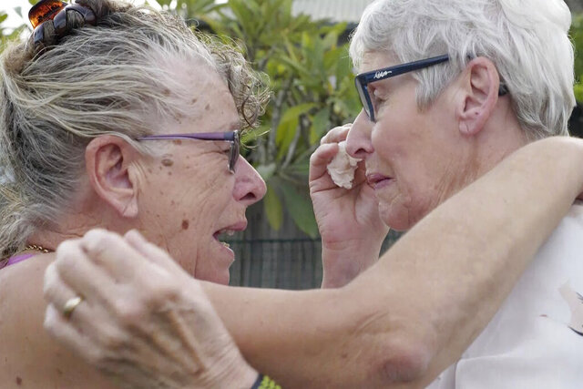 Christine Archer, right, and her sister Gail Baker cry as they are reunited in Bowraville, Australia Wednesday, May 20, 2020. Australia had rejected Archer's request for permission to fly from New Zealand four times before her story attracted media attention. Her only sister Baker was diagnosed with incurable ovarian cancer in late March after both countries stopped international travel. Baker has perhaps weeks to live. Archer was eventually allowed to fly to Sydney and spent only a week in hotel quarantine before testing negative for the coronavirus. (AuBC via AP)