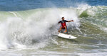 A surfer falls off his board just north of the San Clemente Pier in San Clemente, Calif., as a large swell hits the beaches of Orange County, Saturday, July 4, 2020. (Mark Rightmire/The Orange County Register via AP)