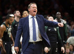 Milwaukee Bucks head coach Mike Budenholzer instructs his team in the second quarter of an NBA basketball game against the Boston Celtics, Friday, Dec. 21, 2018, in Boston. (AP Photo/Elise Amendola)