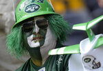 A New York Jets fan takes their seat before an NFL football game between the New York Jets and the Atlanta Falcons at the Tottenham Hotspur stadium in London, England, Sunday, Oct. 10, 2021. (AP Photo/Alastair Grant)