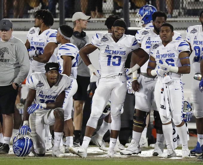 Memphis players watch the final minutes of the second half of the American Athletic Conference championship NCAA college football game against Central Florida, Saturday, Dec. 1, 2018, in Orlando, Fla. (AP Photo/John Raoux)