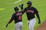 Cleveland Indians' Carlos Santana (41) celebrates the two-run home run hit by Franmil Reyes (32) in the eighth inning during a baseball game against the Cincinnati Reds in Cincinnati, Tuesday, Aug. 4, 2020. (AP Photo/Aaron Doster)
