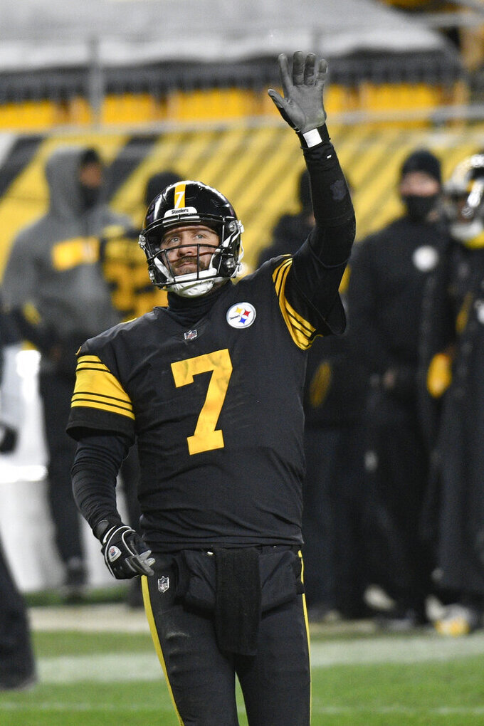 Pittsburgh Steelers quarterback Ben Roethlisberger celebrates after throwing a touchdown pass to wide receiver JuJu Smith-Schuster during the second half of the team's NFL football game against the Baltimore Ravens, Wednesday, Dec. 2, 2020, in Pittsburgh. (AP Photo/Don Wright)