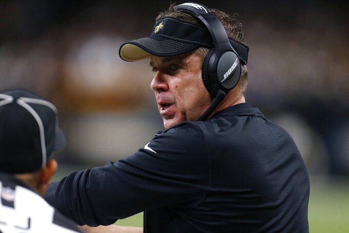 New Orleans Saints head coach Sean Payton talks on the sideline in the first half of an NFL football game against the Indianapolis Colts in New Orleans, Monday, Dec. 16, 2019. The Saints won 34-7. (AP Photo/Butch Dill)
