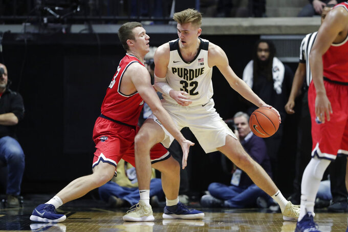 Purdue center Matt Haarms (32) drives on Belmont center Nick Muszynski (33) during the first half of an NCAA college basketball game in West Lafayette, Ind., Saturday, Dec. 29, 2018. (AP Photo/Michael Conroy)