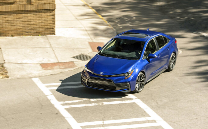 This photo from Toyota shows the Corolla sedan. It's not as enjoyable to drive as the Civic but is otherwise strong on value. (Toyota via AP)