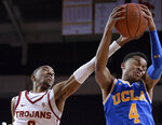 UCLA guard Jaylen Hands, right, grabs a rebound away from Southern California guard Shaqquan Aaron during the first half of an NCAA college basketball game Saturday, Jan. 19, 2019, in Los Angeles. (AP Photo/Mark J. Terrill)