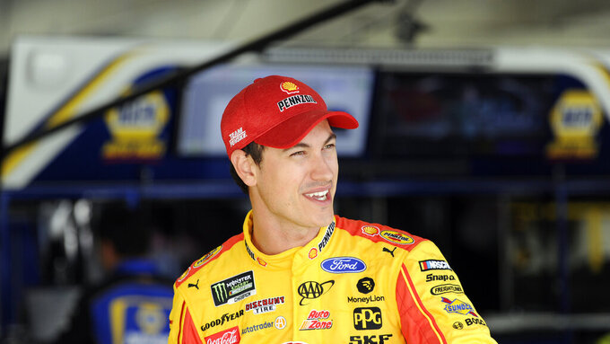 Joey Logano waits during practice for Sunday's NASCAR Cup Series auto race at Charlotte Motor Speedway in Concord, N.C., Saturday, Sept. 28, 2019. (AP Photo/Mike McCarn)