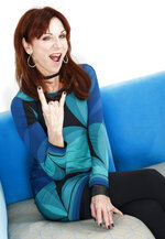 "In this July 26, 2018 photo, actress Marilu Henner poses for a portrait in New York to promote her seventh Broadway show, ""Gettin' The Band Back Together,"" which opens on August 13. (Photo by Brian Ach/Invision/AP)"