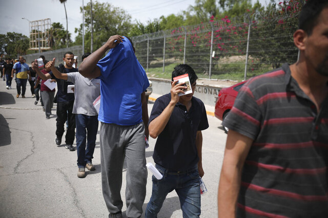 "FILE - In this July 31, 2019, file photo, migrants return to Mexico, using the Puerta Mexico bridge that crosses the Rio Grande river in Matamoros, Mexico, on the border with Brownsville, Texas. A federal judge on Tuesday, Jan. 26, 2021, barred the U.S. government from enforcing a 100-day deportation moratorium that is a key immigration priority of President Joe Biden. U.S. District Judge Drew Tipton issued a temporary restraining order sought by Texas, which sued on Friday against a Department of Homeland Security memo that instructed immigration agencies to pause most deportations. Tipton said the Biden administration had failed ""to provide any concrete, reasonable justification for a 100-day pause on deportations."" (AP Photo/Emilio Espejel, File)"