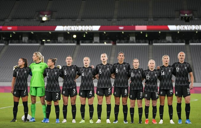 New Zealand sing the national anthem before the start a women's soccer match against Australia at the 2020 Summer Olympics, Wednesday, July 21, 2021, in Tokyo. (AP Photo/Ricardo Mazalan)