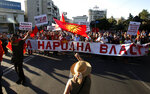 People wave the old national flags and carry banners with patriotic slogans, protesting the change of country's name to North Macedonia and