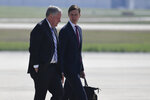 White House chief of staff Mark Meadows, left, talks with White House senior adviser Jared Kushner as they walk towards Air Force One at Andrews Air Force Base in Md., Tuesday, June 23, 2020, to travel with President Donald Trump to Arizona. (AP Photo/Susan Walsh)