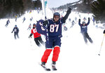 Fans of the New England Patriots NFL football team ski en masse at the Sugarloaf ski resort, Sunday, Feb. 3, 2019, in Carrabassett Valley, Maine. About 200 skiers took part to show their support for the Patriots prior to today's Super Bowl game against the Los Angeles Rams. (AP Photo/Robert F. Bukaty)