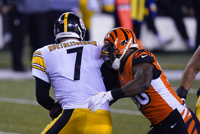 Cincinnati Bengals' Carl Lawson (58) sacks Pittsburgh Steelers quarterback Ben Roethlisberger (7) during the first half of an NFL football game, Monday, Dec. 21, 2020, in Cincinnati. (AP Photo/Michael Conroy)