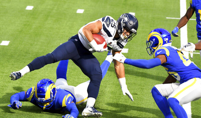 Seattle Seahawks running back Travis Homer (25) runs for a first down against the Los Angeles Rams in the first half of an NFL football game in Inglewood, Calif., Sunday, Nov. 15, 2020. (Keith Birmingham/The Orange County Register via AP)