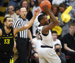 Oregon forward Paul White, left, tries to steal the ball from Colorado guard McKinley Wright IV who looks to pass in the first half of an NCAA basketball game Saturday, Feb. 2, 2019, in Boulder, Colo. (AP Photo/David Zalubowski)