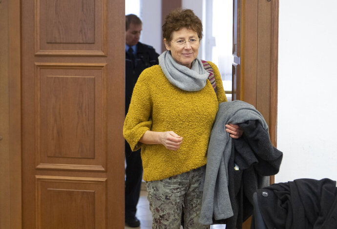 Gynaecologist Kristina Haenel enters the hearing room of the state court in Giessen, Germany, Thursday, Dec. 12, 2019. Gynaecologist Kristina Haenel has been convicted again of violating a ban on advertising abortions. (Boris Roessler/dpa via AP)