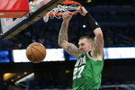 Boston Celtics forward Daniel Theis dunks against the Orlando Magic during the second half of an NBA basketball game, Friday, Jan. 24, 2020, in Orlando, Fla. (AP Photo/John Raoux)