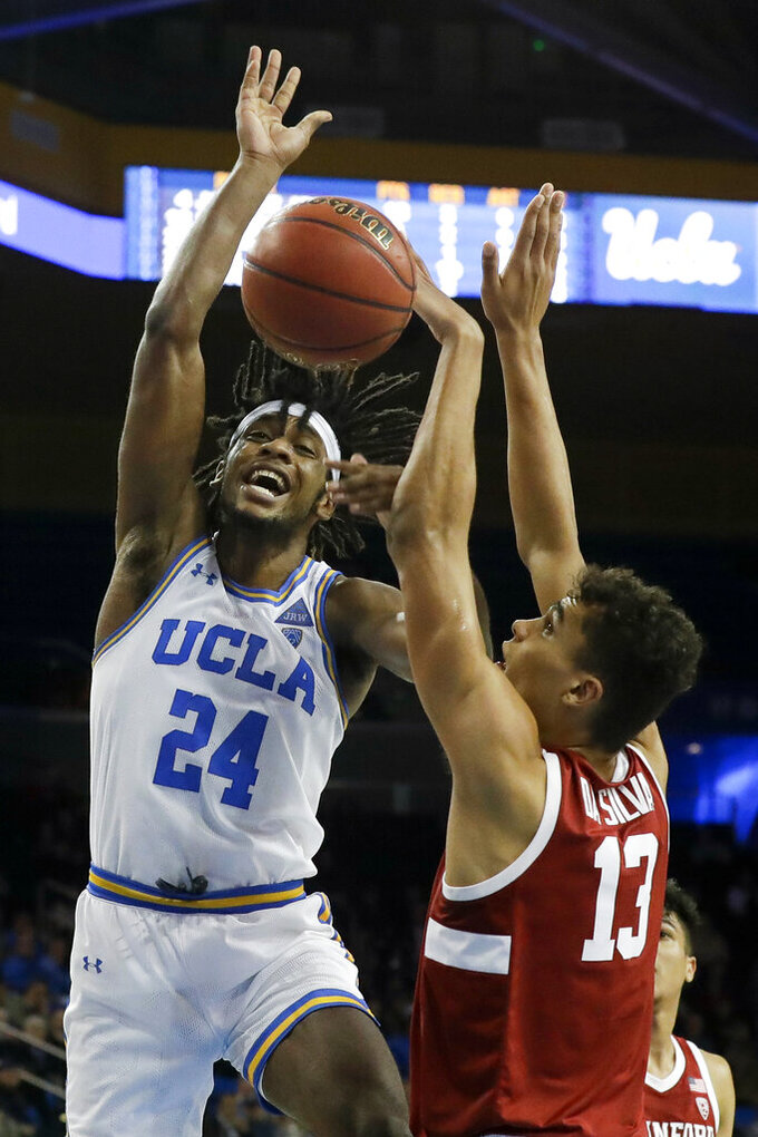 Stanford forward Oscar da Silva, right, blocks a shot by UCLA forward Jalen Hill during the second half of an NCAA college basketball game in Los Angeles, Wednesday, Jan. 15, 2020. (AP Photo/Chris Carlson)