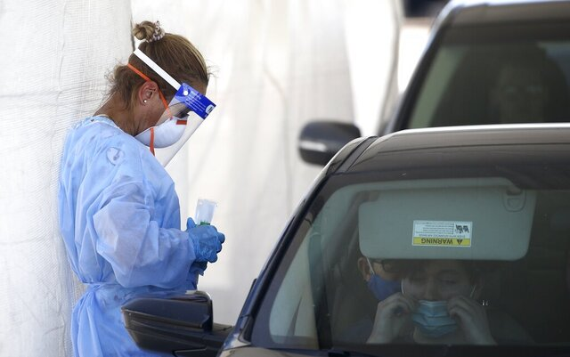 People get tested at a drive thru coronavirus testing site at South Mountain Community College Thursday, July 9, 2020, in Phoenix. (AP Photo/Ross D. Franklin)