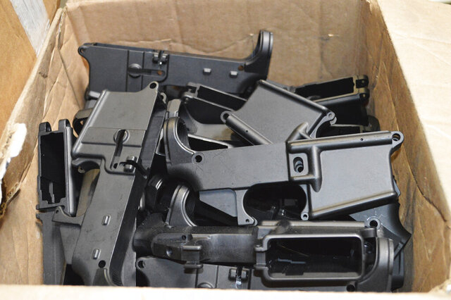 This photo provided by the U.S. Department of Justice shows AR-15 lower receivers, which federal agents have seized, including these unfinished ones taken in 2014 in California, for firearms investigations nationwide. For decades, the federal government has treated the mechanism called the lower receiver as the essential piece of the semiautomatic rifle, which has been used in some of the nation's deadliest mass shootings. But some defense attorneys have recently argued that the part alone does not meet the definition in the law. (U.S. Department of Justice via AP)