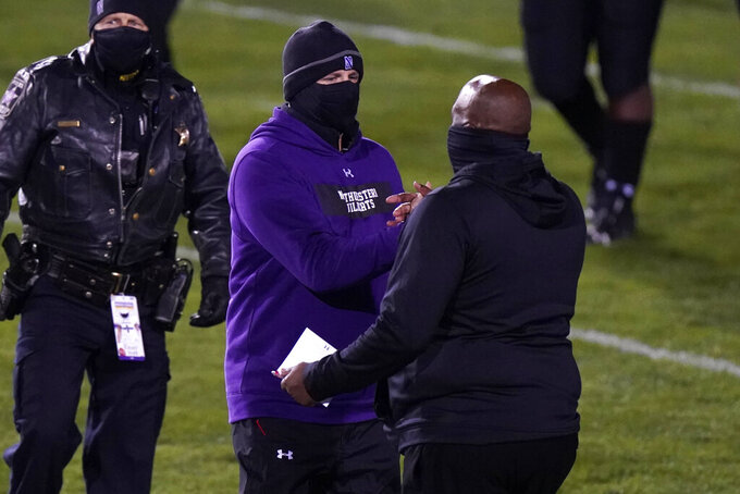Northwestern head coach Pat Fitzgerald, center, shakes hands with Maryland head coach Mike Locksley, right, after Northwestern won an NCAA college football game in Evanston, Ill., Saturday, Oct. 24, 2020. (AP Photo/Nam Y. Huh)