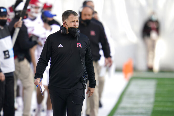 FILE - In this Dec. 12, 2020, file photo, Rutgers head coach Greg Schiano looks on during the second half of an NCAA college football game against Maryland in College Park, Md. Schiano is kicking off the second season of his second stint at Rutgers with another first this time around. The Scarlet Knights are going to play host to Temple on Thursday night in a home game that will have no restriction on fans. (AP Photo/Julio Cortez, File)