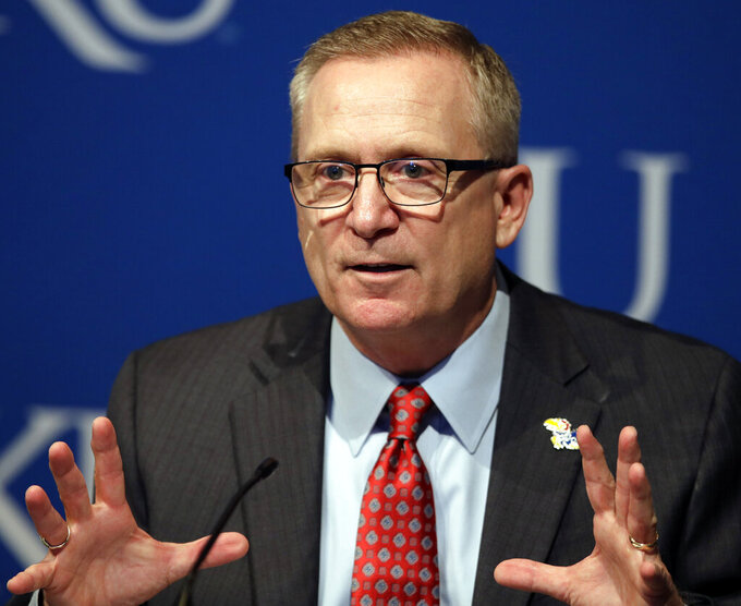 FILE - In this July 11, 2018, file photo, Kansas athletic director Jeff Long answers questions during a news conference in Lawrence, Kan. Kansas has fired athletic director Jeff Long less than two days after mutually parting with Les Miles amid sexual misconduct allegations dating to the football coach's time at LSU, a person familiar with the decision told The Associated Press on Wednesday, March 10, 2021.  (AP Photo/Orlin Wagner, File)