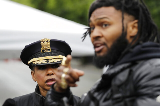 Seattle Police Chief Carmen Best, left, listens to activist Raz Simone as they talk near a plywood-covered and closed Seattle police precinct Tuesday, June 9, 2020, in Seattle, following protests over the death of George Floyd. Floyd, a black man died after being restrained by Minneapolis police officers on May 25. Under pressure from city councilors, protesters and dozens of other elected leaders who have demanded that officers dial back their tactics, the police department on Monday removed barricades near its East Precinct building in the Capitol Hill neighborhood, where protesters and riot squads had faced off nightly. Protesters were allowed to march and demonstrate in front of the building, and the night remained peaceful. (AP Photo/Elaine Thompson)