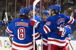 New York Rangers defenseman Tony DeAngelo, center, celebrates after scoring a goal during the second period of an NHL hockey game against the Detroit Red Wings, Wednesday, Nov. 6, 2019, at Madison Square Garden in New York. (AP Photo/Mary Altaffer)