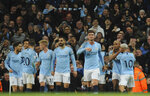 Manchester City's Vincent Kompany, second right, celebrates with teammates after scoring his side's opening goal during the English Premier League soccer match between Manchester City and Leicester City at the Etihad stadium in Manchester, England, Monday, May 6, 2019. (AP Photo/Rui Vieira)