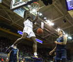 Washington's Isaiah Stewart (33) dunks as San Diego's Alex Floresca (15) and Jared Rodriguez (20) stand by during the first half of an NCAA college basketball game, Sunday, Nov. 24, 2019, in Seattle. (Joshua Bessex/The News Tribune via AP)