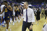 Washington coach Mike Hopkins walks of the court after Washington defeated California 87-52 in an NCAA college basketball game Saturday, Feb. 22, 2020, in Seattle. (AP Photo/Ted S. Warren)